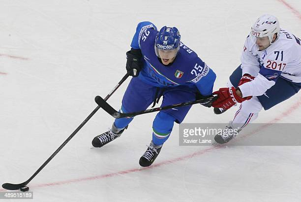 Joachim Ramoser of Italy and Anthony Guttig of France in action during the 2014 IIHF World Championship between Italy and France at Chizhovka arena...