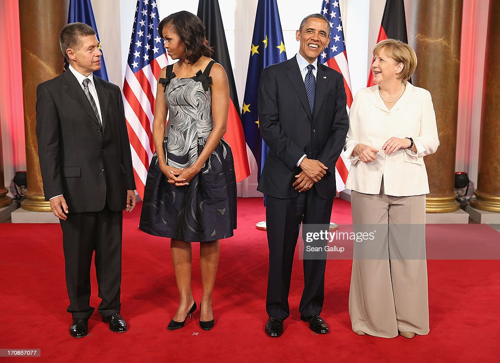 U.S. <a gi-track='captionPersonalityLinkClicked' href=/galleries/search?phrase=Joachim+Sauer&family=editorial&specificpeople=687595 ng-click='$event.stopPropagation()'>Joachim Sauer</a>, First Lady <a gi-track='captionPersonalityLinkClicked' href=/galleries/search?phrase=Michelle+Obama&family=editorial&specificpeople=2528864 ng-click='$event.stopPropagation()'>Michelle Obama</a>, U.S. President <a gi-track='captionPersonalityLinkClicked' href=/galleries/search?phrase=Barack+Obama&family=editorial&specificpeople=203260 ng-click='$event.stopPropagation()'>Barack Obama</a> and German Chancellor <a gi-track='captionPersonalityLinkClicked' href=/galleries/search?phrase=Angela+Merkel&family=editorial&specificpeople=202161 ng-click='$event.stopPropagation()'>Angela Merkel</a> attend the dinner given in honour of President Obama at the Orangerie of Schloss Charlottenburg palace on June 19, 2013 in Berlin, Germany. Obama is visiting Berlin for the first time during his presidency and his speech at the Brandenburg Gate is to be the highlight. Obama will be speaking close to the 50th anniversary of the historic speech by then U.S. President John F. Kennedy in Berlin in 1963, during which he proclaimed the famous sentence: 'Ich bin ein Berliner.'