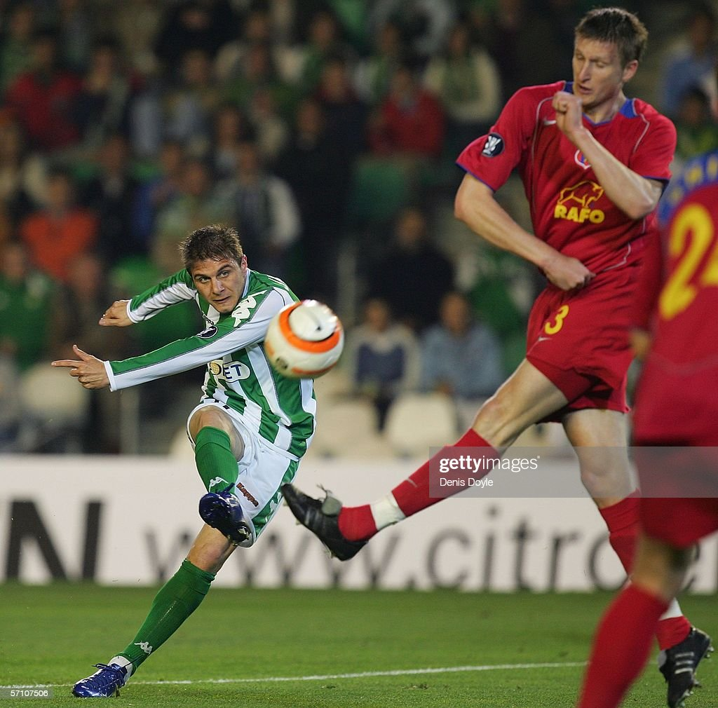 Joajuin Gonzalez of Real Betis shoots past Goian of Steaua Bucharest during the UEFA Cup Last 16 Second Leg match between Real Betis and Steaua...