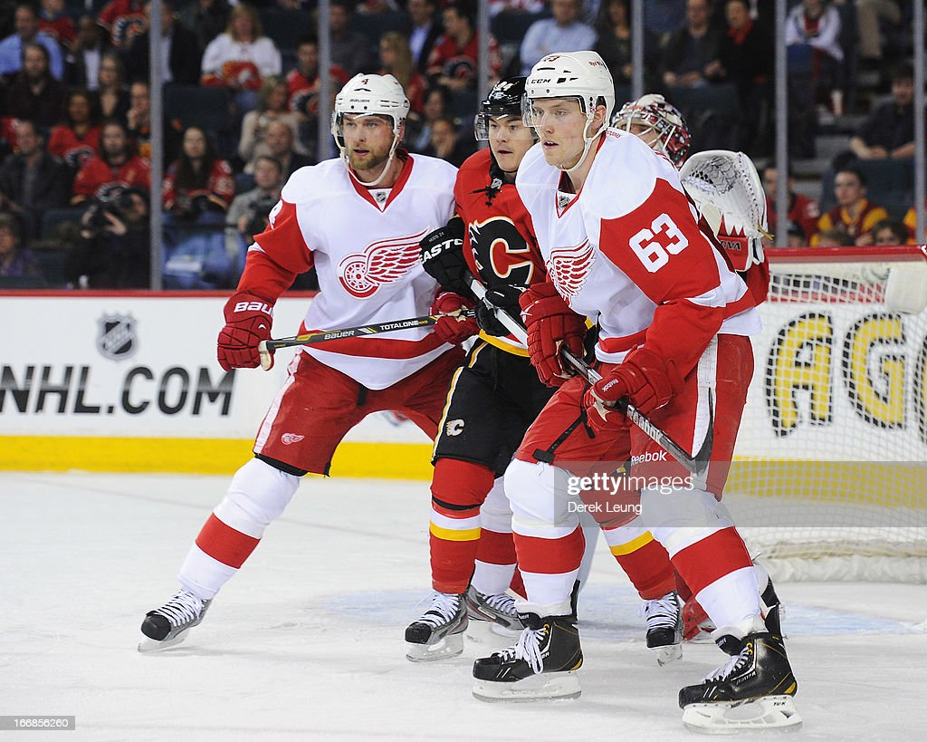 Joakim Andersson #63 and <a gi-track='captionPersonalityLinkClicked' href=/galleries/search?phrase=Jakub+Kindl&family=editorial&specificpeople=716743 ng-click='$event.stopPropagation()'>Jakub Kindl</a> #4 of the Detroit Red Wings help their goaltender <a gi-track='captionPersonalityLinkClicked' href=/galleries/search?phrase=Jimmy+Howard&family=editorial&specificpeople=2118637 ng-click='$event.stopPropagation()'>Jimmy Howard</a> #35 defend against <a gi-track='captionPersonalityLinkClicked' href=/galleries/search?phrase=Jiri+Hudler&family=editorial&specificpeople=2118675 ng-click='$event.stopPropagation()'>Jiri Hudler</a> #24 of the Calgary Flames during an NHL game at Scotiabank Saddledome on April 17, 2013 in Calgary, Alberta, Canada.