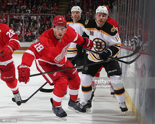 Joakim Andersson of the Detroit Red Wings battles along the boards with Gregory Campbell of the Boston Bruins during Game Three of the First Round of...