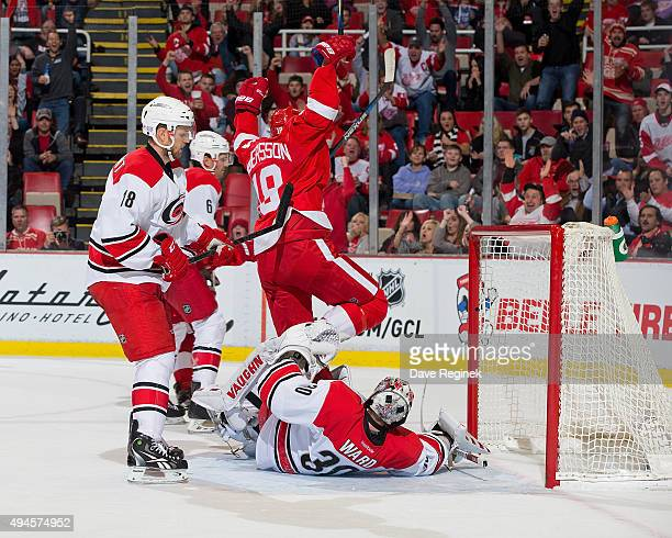 Joakim Andersson of the Detroit Red Wings celebrates a goal by Jakub Kindl of the Red Wings against Cam Ward of the Carolina Hurricanes during an NHL...