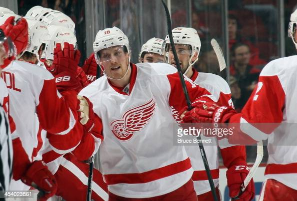 Joakim Andersson of the Detroit Red Wings celebrates his goal against the New Jersey Devils at 1924 of the second period at the Prudential Center on...