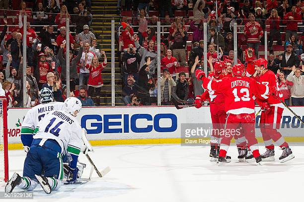Joakim Andersson of the Detroit Red Wings celebrates his goal with teammates Pavel Datsyuk Danny DeKeyser and Jonathan Ericsson in front of...