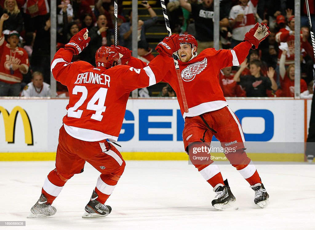 Joakim Andersson of the Detroit Red Wings celebrates his second period goal with Damien Brunner while playing the Chicago Blackhawks in Game Six of...