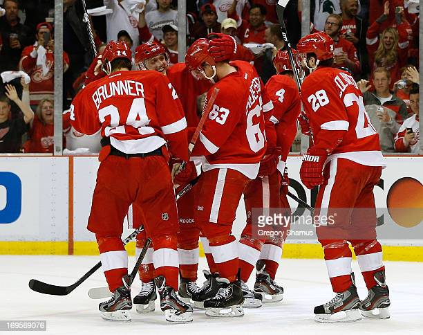Joakim Andersson of the Detroit Red Wings celebrates his second period goal with Carlo Colaiacovo Jakub Kindl Gustav Nyquist and Damien Brunner while...