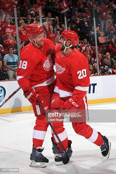 Joakim Andersson of the Detroit Red Wings congratulates Drew Miller for scoring a goal during an NHL game against the New Jersey Devils on March 7...