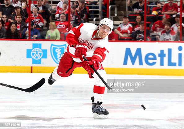 Joakim Andersson of the Detroit Red Wings fires a puck into the zone during their NHL game against the Carolina Hurricanes at PNC Arena on April 11...