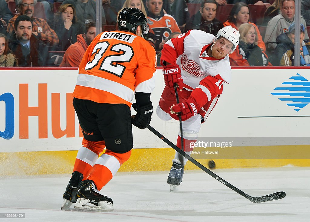 Joakim Andersson #18 of the Detroit Red Wings has hit shot deflected by <a gi-track='captionPersonalityLinkClicked' href=/galleries/search?phrase=Mark+Streit&family=editorial&specificpeople=636976 ng-click='$event.stopPropagation()'>Mark Streit</a> #32 of the Philadelphia Flyers at the Wells Fargo Center on January 28, 2014 in Philadelphia, Pennsylvania. The Flyers won 5-0.