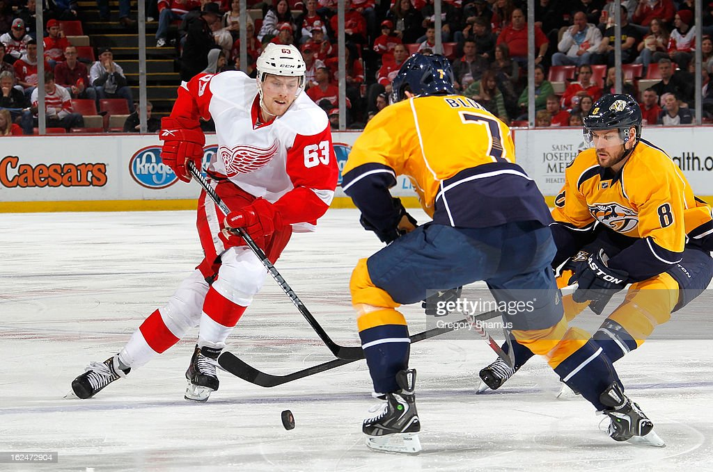 Joakim Andersson #63 of the Detroit Red Wings races for the puck behind <a gi-track='captionPersonalityLinkClicked' href=/galleries/search?phrase=Jonathon+Blum&family=editorial&specificpeople=4306183 ng-click='$event.stopPropagation()'>Jonathon Blum</a> #7 and Kevin Klein #8 of the Nashville Predators during the third period at Joe Louis Arena on February 23, 2013 in Detroit, Michigan. Detroit won the game 4-0.