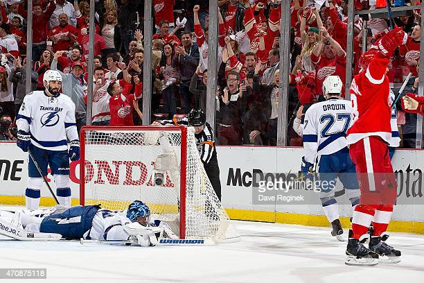 Joakim Andersson of the Detroit Red Wings raises his hands after scoring a goal on goalie Ben Bishop of the Tampa Bay Lightning in Game Four of the...