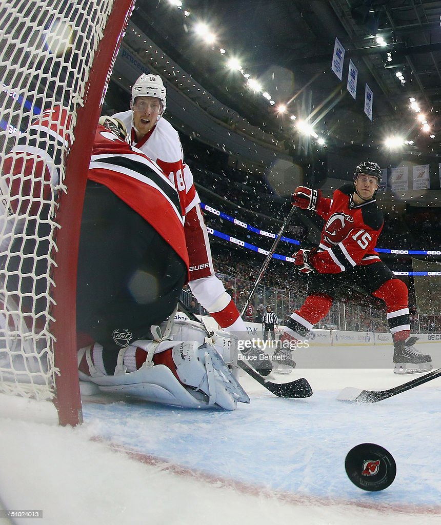 Joakim Andersson of the Detroit Red Wings scores against Cory Schneider of the New Jersey Devils at 1924 of the second period at the Prudential...