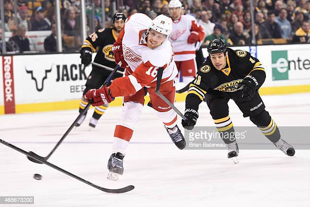 Joakim Andersson of the Detroit Red Wings shoots the puck against Gregory Campbell of the Boston Bruins at the TD Garden on March 8 2015 in Boston...