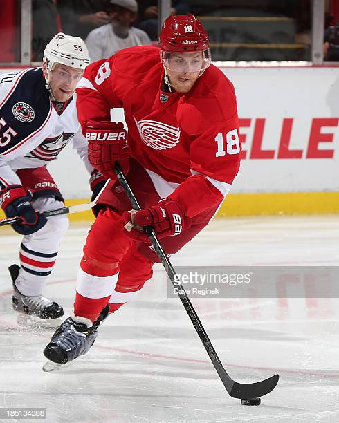 Joakim Andersson of the Detroit Red Wings skates up ice with the puck against the during a NHL game against the Columbus Blue Jackets at Joe Louis...
