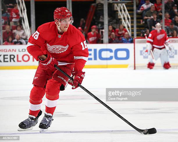 Joakim Andersson of the Detroit Red Wings skates up ice with the puck against the Nashville Predators during an NHL game at Joe Louis Arena on...