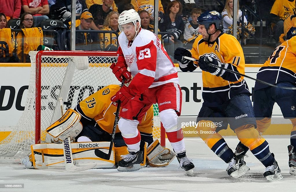 Joakim Andersson #63 of the Detroit Red Wings tries to deflect a puck in front of <a gi-track='captionPersonalityLinkClicked' href=/galleries/search?phrase=David+Legwand&family=editorial&specificpeople=202553 ng-click='$event.stopPropagation()'>David Legwand</a> #11 of the Nashville Predators at the Bridgestone Arena on April 14, 2013 in Nashville, Tennessee.
