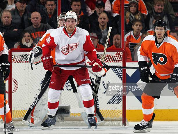 Joakim Andersson of the Detroit Red Wings waits to deflect a shot on goal against Braydon Coburn and Steve Mason the Philadelphia Flyers on January...