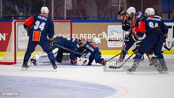 Joakim Hillding of Vaxjo Lakers and Joacim Andersson Goaltender of Vaxjo Lakers covers up the puck during the Champions Hockey League Round of 32...