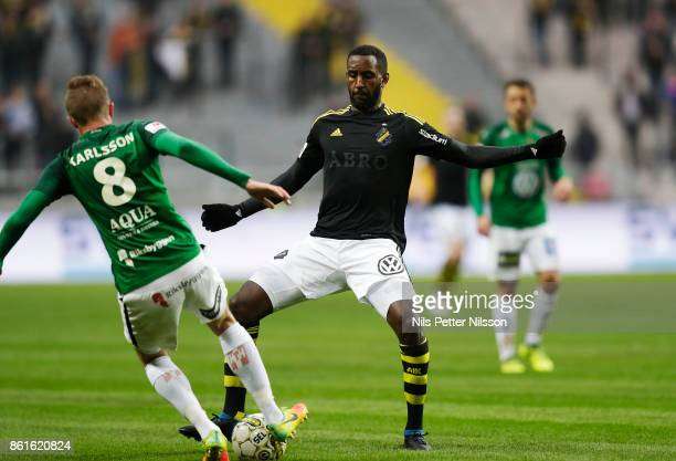 Joakim Karlsson of Jonkopings Sodra and Henok Goitom of AIK competes for the ball during the Allsvenskan match between AIK and Jonkopings Sodra IF at...