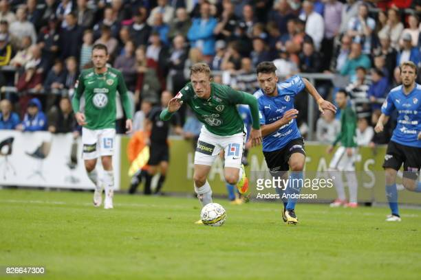 Joakim Karlsson of Jonkopings Sodra and Sead Haksabanovic of Halmstad BK competes for the ball during the Allsvenskan match between Halmstad BK and...