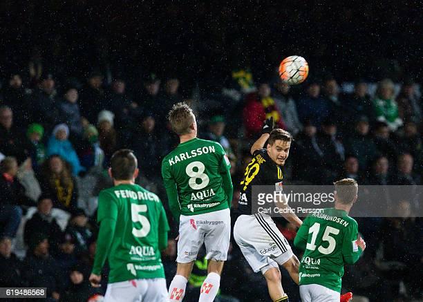 Joakim Karlsson of Jonkopings Sodra in a header against Amin Affane of AIK during the Allsvenskan match between Jonkoping Sodra IF and AIK at...