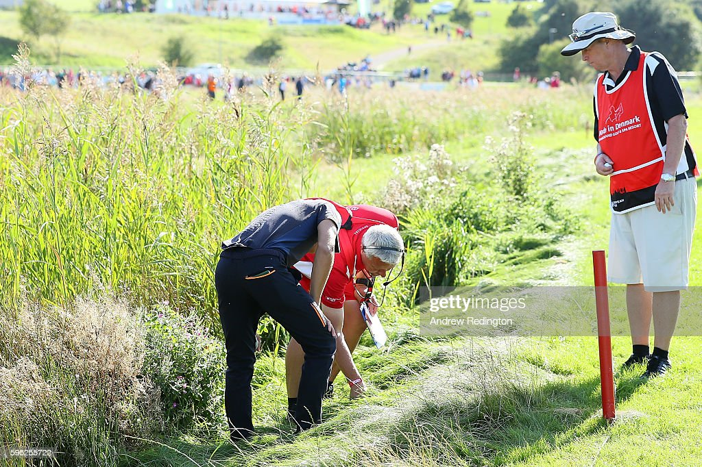 Joakim Lagergren of Sweden looks for his ball on the 18th hole during the third round of Made in Denmark at Himmerland Golf & Spa Resort on August 27, 2016 in Aalborg, Denmark.