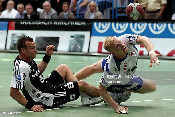 Joakim Larsson of Grosswallstadt is challenged by Christian Zeitz of Kiel during the Toyota Handball Bundesliga match between TV Grosswallstadt and...