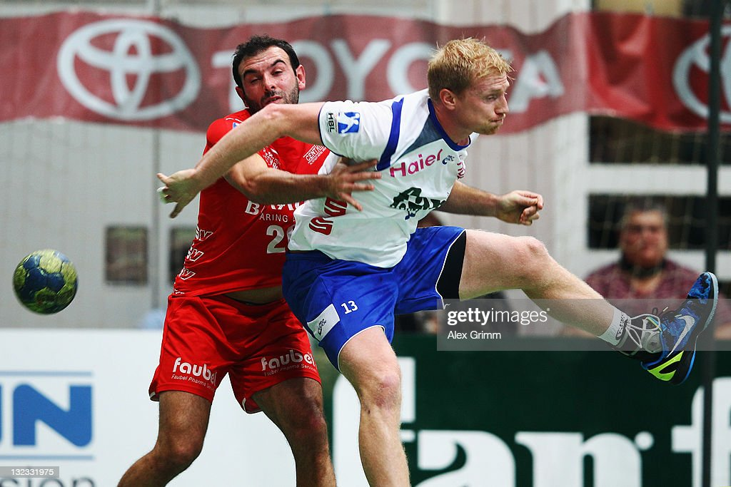 Joakim Larsson (front) of Grosswallstadt is challenged by Savas Karipidis of Melsungen during the Toyota Handball Bundesliga match between T VGrosswallstadt and MT Melsungen at f.a.n. frankenstolz arena on November 11, 2011 in Aschaffenburg, Germany.
