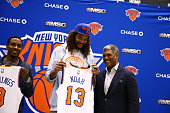 Joakim Noah and Brandon Jennings and General Manager Steve Mills of the New York Knicks attend a press conference at the Madison Square Garden...