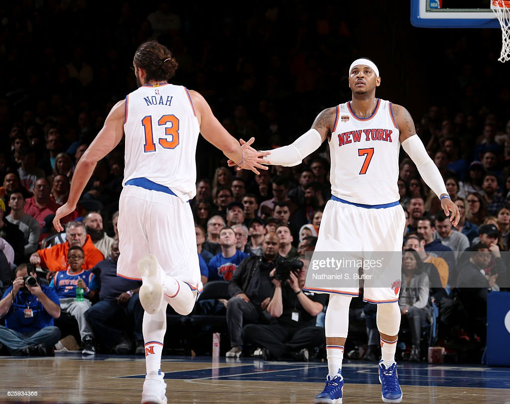 Joakim Noah #13 and Carmelo Anthony #7 of the New York Knicks high five during the game against the Charlotte Hornets at Madison Square Garden in New York, New York.