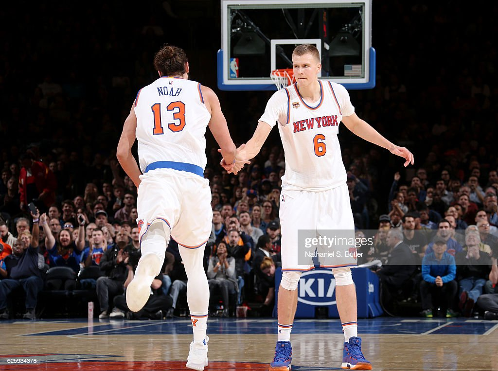 Joakim Noah #13 and Kristaps Porzingis #6 of the New York Knicks high five during the game against the Charlotte Hornets at Madison Square Garden in New York, New York.