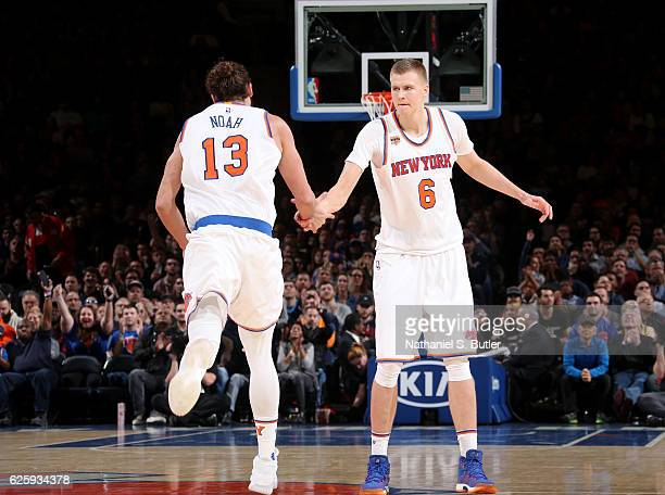 Joakim Noah and Kristaps Porzingis of the New York Knicks high five during the game against the Charlotte Hornets at Madison Square Garden in New...