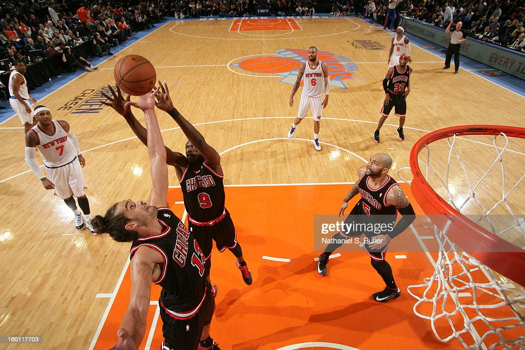Joakim Noah #13 and Luol Deng #9 of the Chicago Bulls go up for a rebound against the New York Knicks on January 11, 2013 at Madison Square Garden in New York City.