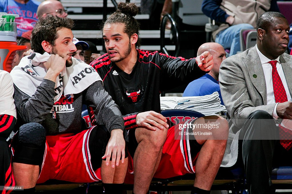 <a gi-track='captionPersonalityLinkClicked' href=/galleries/search?phrase=Joakim+Noah&family=editorial&specificpeople=699038 ng-click='$event.stopPropagation()'>Joakim Noah</a> #13 and <a gi-track='captionPersonalityLinkClicked' href=/galleries/search?phrase=Marco+Belinelli&family=editorial&specificpeople=847592 ng-click='$event.stopPropagation()'>Marco Belinelli</a> #8 of the Chicago Bulls speak on the bench during a game against the Detroit Pistons on April 7, 2013 at The Palace of Auburn Hills in Auburn Hills, Michigan.