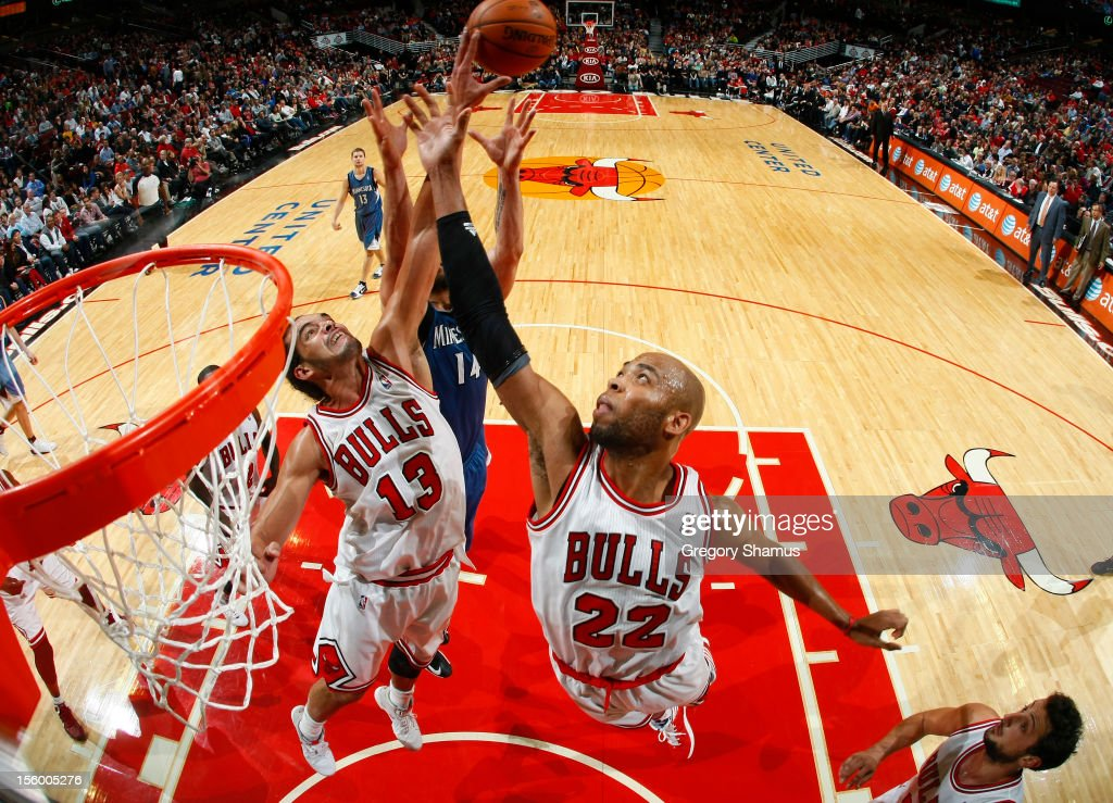 Joakim Noah #13 and Taj Gibson #22 of the Chicago Bulls battle for a rebound with Nikola Pekovic #14 of the Minnesota Timberwolves on November 10, 2012 at the United Center in Chicago, Illinois.
