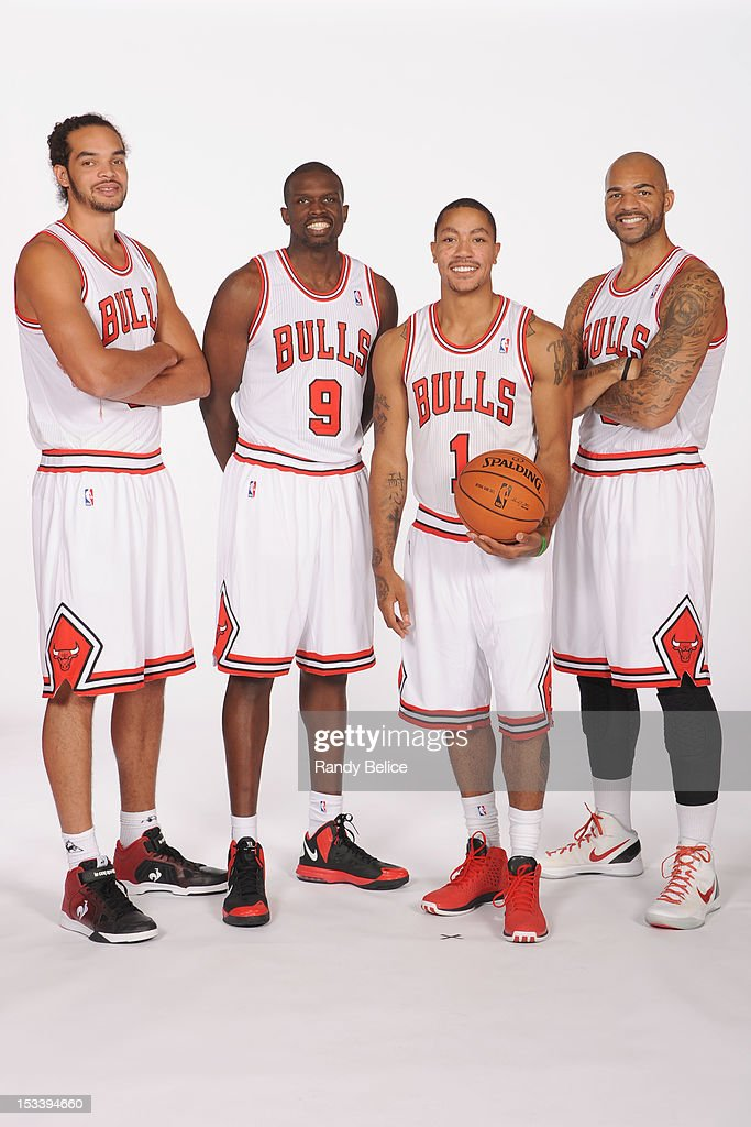 Joakim Noah #13, Luol Deng #9, Derrick Rose #1 and Carlos Boozer #5 of the Chicago Bulls pose for a group photo as part of 2012-13 Media Day on October 1, 2012 at the Sheri L. Berto Center in Deerfield, Illinois.