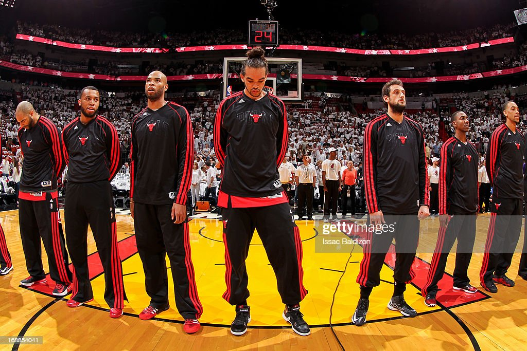 Joakim Noah #13 of the Chicago Bulls and teammates listen to the National Anthem before playing against the Miami Heat in Game Five of the Eastern Conference Semifinals during the 2013 NBA Playoffs on May 15, 2013 at American Airlines Arena in Miami, Florida.