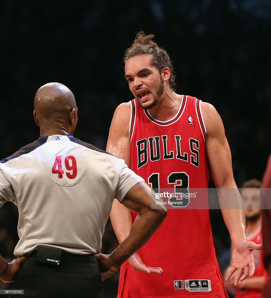Joakim Noah #13 of the Chicago Bulls argues a call with referee Tom Washington #49 in the game against the Brooklyn Nets during Game Five of the Eastern Conference Quarterfinals of the 2013 NBA Playoffs at the Barclays Center on April 29, 2013 in New York City. The Nets defeated the Bulls 110-91.