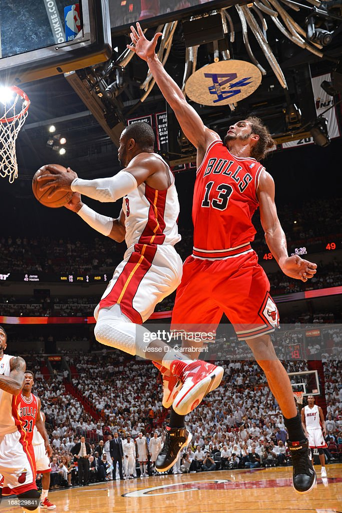 Joakim Noah #13 of the Chicago Bulls attempts to block a shot against Dwyane Wade #3 of the Miami Heat in Game One of the Eastern Conference Semifinals during the 2013 NBA Playoffs on May 6, 2013 at American Airlines Arena in Miami, Florida.