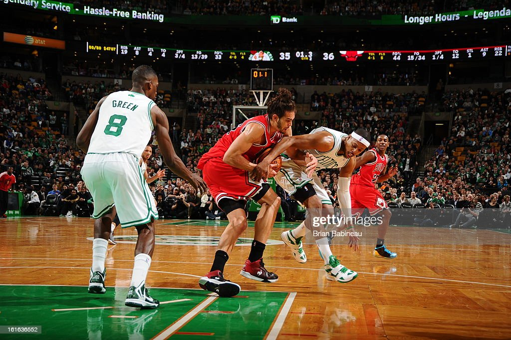 Joakim Noah #13 of the Chicago Bulls battles for a loose ball against Paul Pierce #34 of the Boston Celtics on February 13, 2013 at the TD Garden in Boston, Massachusetts.