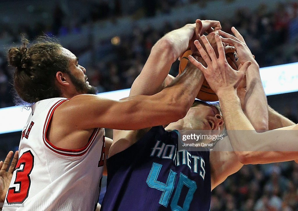 Joakim Noah #13 of the Chicago Bulls battles for a rebound with Cody Zeller #40 of the Charlotte Hornets at the United Center on February 25, 2015 in Chicago, Illinois. The Hornets defeated the Bulls 98-86.