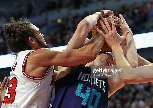 Joakim Noah of the Chicago Bulls battles for a rebound with Cody Zeller of the Charlotte Hornets at the United Center on February 25 2015 in Chicago...