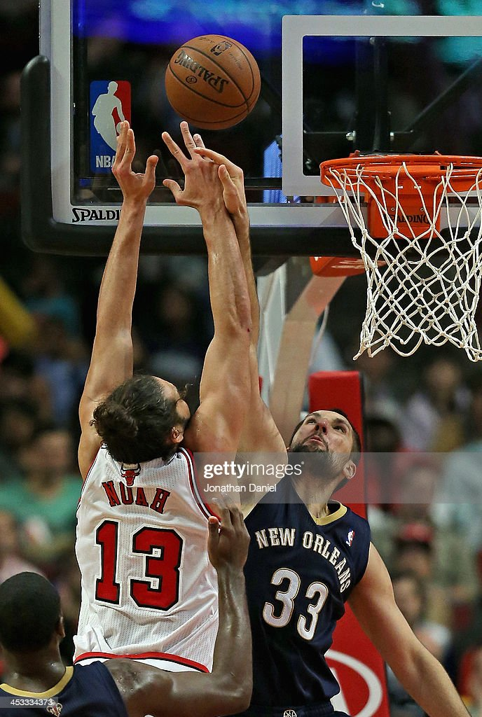 Joakim Noah #13 of the Chicago Bulls battles for a rebound with Ryan Anderson #33 of the New Orleans Pelicans at the United Center on December 2, 2013 in Chicago, Illinois. The Pelicans defeated the Bulls 131-128 in triple overtime.