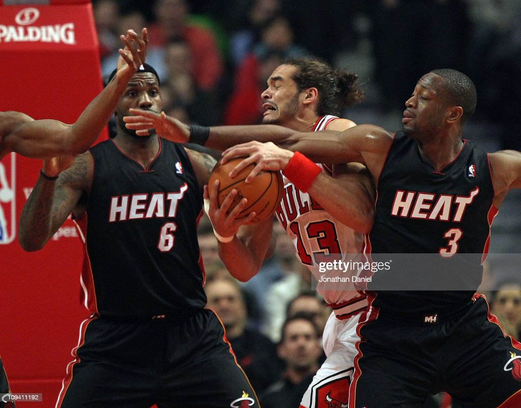<a gi-track='captionPersonalityLinkClicked' href=/galleries/search?phrase=Joakim+Noah&family=editorial&specificpeople=699038 ng-click='$event.stopPropagation()'>Joakim Noah</a> #13 of the Chicago Bulls battles for control of the ball with <a gi-track='captionPersonalityLinkClicked' href=/galleries/search?phrase=LeBron+James&family=editorial&specificpeople=201474 ng-click='$event.stopPropagation()'>LeBron James</a> #6 and <a gi-track='captionPersonalityLinkClicked' href=/galleries/search?phrase=Dwyane+Wade&family=editorial&specificpeople=201481 ng-click='$event.stopPropagation()'>Dwyane Wade</a> #3 of the Miami Heat at the United Center on February 24, 2011 in Chicago, Illinois.