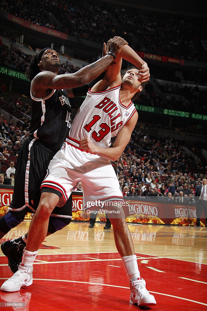 <a gi-track='captionPersonalityLinkClicked' href=/galleries/search?phrase=Joakim+Noah&family=editorial&specificpeople=699038 ng-click='$event.stopPropagation()'>Joakim Noah</a> #13 of the Chicago Bulls battles for positioning against <a gi-track='captionPersonalityLinkClicked' href=/galleries/search?phrase=Gerald+Wallace&family=editorial&specificpeople=202117 ng-click='$event.stopPropagation()'>Gerald Wallace</a> #45 of the Brooklyn Nets on December 15, 2012 at the United Center in Chicago, Illinois.