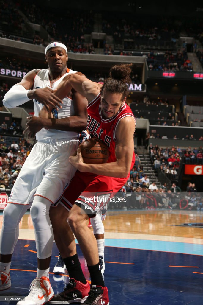 <a gi-track='captionPersonalityLinkClicked' href=/galleries/search?phrase=Joakim+Noah&family=editorial&specificpeople=699038 ng-click='$event.stopPropagation()'>Joakim Noah</a> #13 of the Chicago Bulls battles for the ball against <a gi-track='captionPersonalityLinkClicked' href=/galleries/search?phrase=Brendan+Haywood&family=editorial&specificpeople=202010 ng-click='$event.stopPropagation()'>Brendan Haywood</a> #33 of the Charlotte Bobcats at the Time Warner Cable Arena on February 22, 2013 in Charlotte, North Carolina.