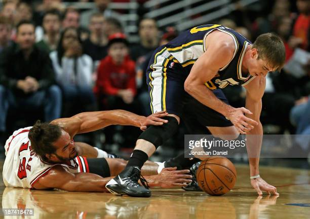 Joakim Noah of the Chicago Bulls battles for the ball with Gordon Hayward of the Utah Jazz at the United Center on November 8 2013 in Chicago...