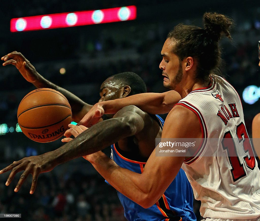 Joakim Noah #13 of the Chicago Bulls battles for the ball with Serge Ibaka #9 of the Oklahoma City Thunder at the United Center on November 8, 2012 in Chicago, Illinois. The Thunder defeated the Bulls 97-91.