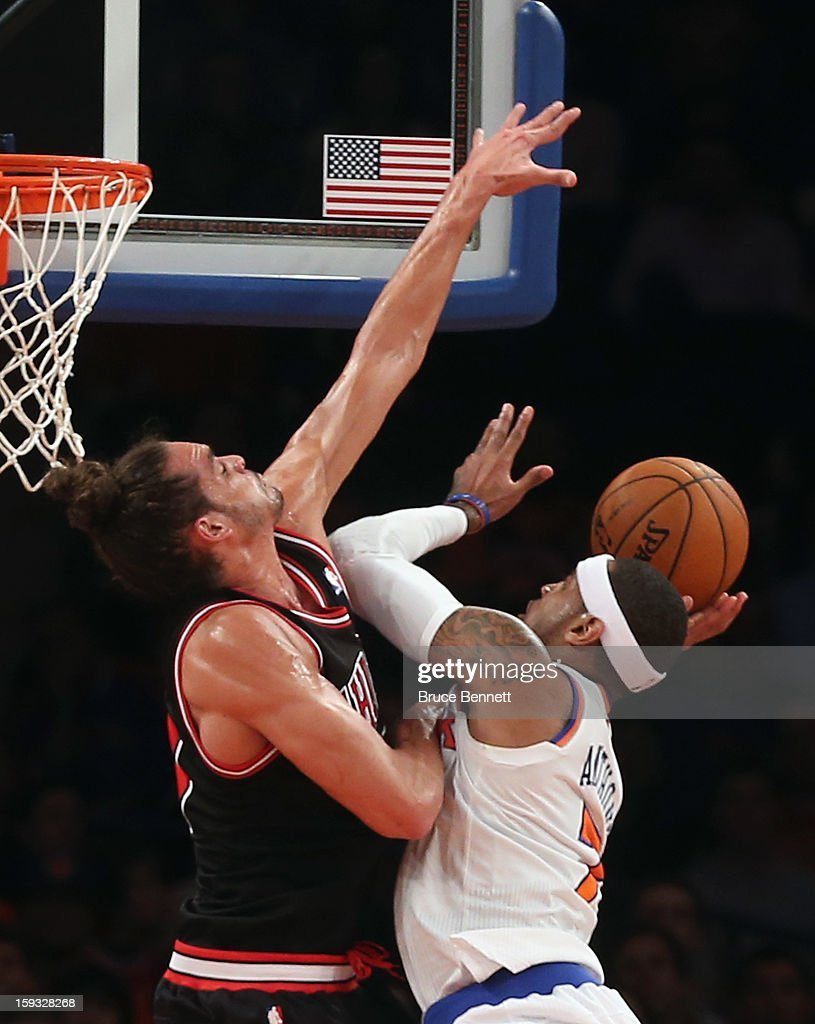 Joakim Noah #13 of the Chicago Bulls blocks a shot by Carmelo Anthony #7 of the New York Knicks in the first half at Madison Square Garden on January 11, 2013 in New York City.