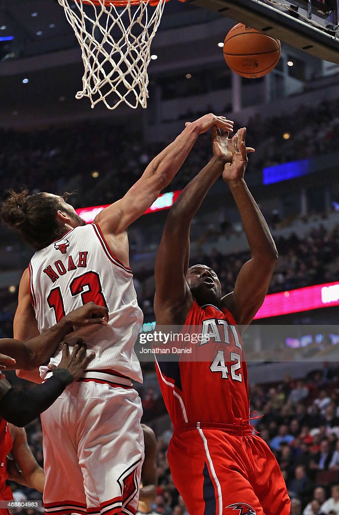 Joakim Noah #13 of the Chicago Bulls blocks a shot by Elton Brand #42 of the Atlanta Hawks at the United Center on February 11, 2014 in Chicago, Illinois.
